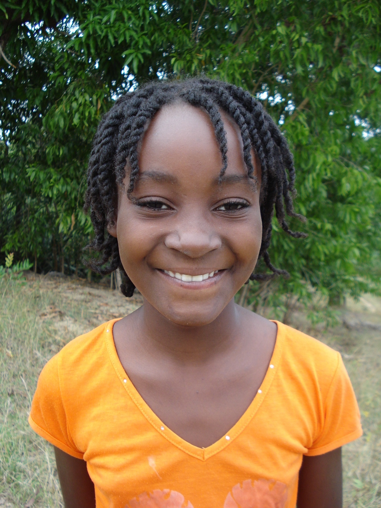 Loudouide, a sponsored child in Haiti, in her community.