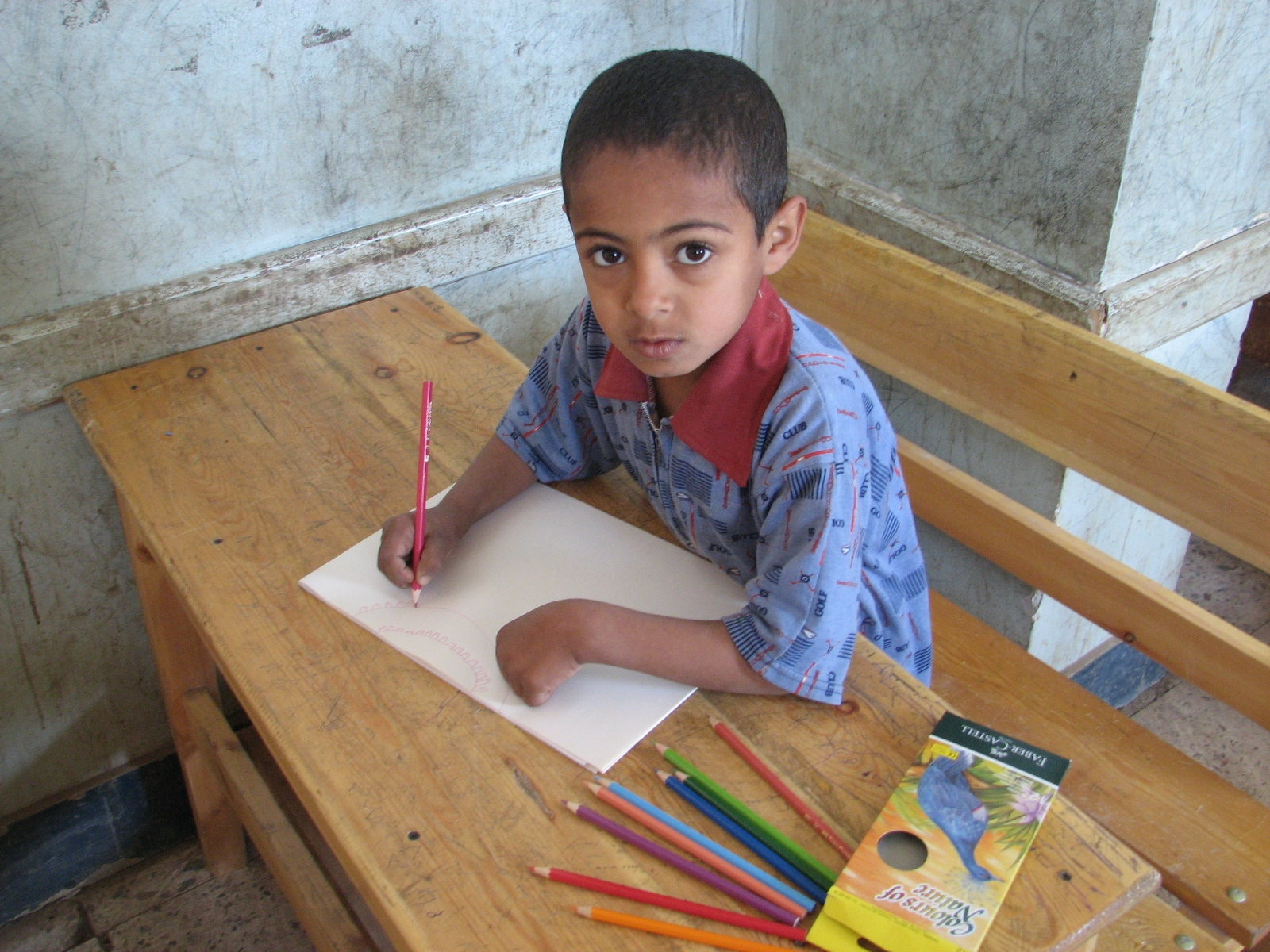Ahmed, a sponsored child, studies at his school in Egypt.