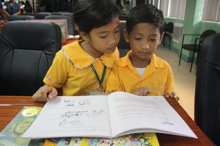 PHCO Rhea and her brother Rhen Rhen love to read. Here they are skimming through the pages of the new books given by Save the Children