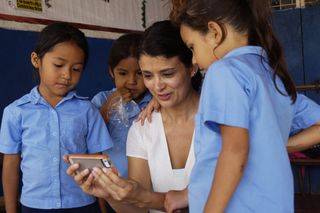 Ana showing Brenda and peers a picture of them
