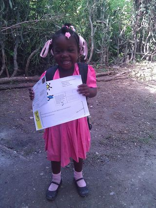 Weslencia-6 years old-received a postcard from her sponsor