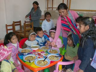 Mom's at Family Center prepare nutritional food for their children