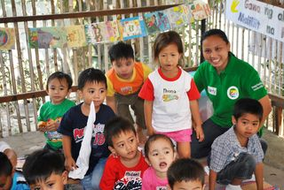 Charity with her students in a Kapitbahay Aralan Session