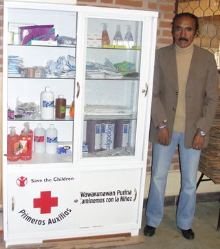 School Administrator Roberto Villegas next to first aid kit