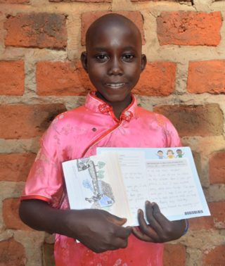 Hajara proudly holding her first letter from her sponsor