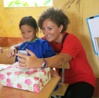 Vuong and one of her sponsors pose for a selfie that has them both smiling