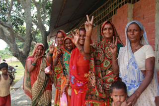 Guheshwori, second from the left, and the other female attendees playfully show the peace sign